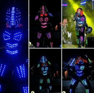 """When the """"Stage Show Boss"""" entered the stage at 3 a.m. in a glowing led-light outfit, there was an overwhelming roar from the crowd."""
