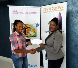 Student Tiffany Bourne receiving sponsorship from Flow's communications coordinator Neilsa Layne