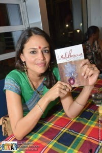 Tishani Doshi with her new collection, The Adulterous Citizen: poems stories essays, following the book signing at the 13th annual St. Martin Book Fair, 2015. (© HNP photo)