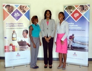 The Students, Ms Florence Fields (l) and Ms Emma Sealy (r) pose for a photograph with Ms Elizabeth Riley, DED CDEMA.