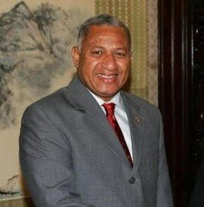 """(IMAGE VIA - Epoch Times) On the 36th anniversary of Kiribati's independence from Britain a few days ago - July 12 - the Prime Minister of Fiji, Voreqe Bainimarama, recognising the plight the small island state faced from climate change and sea-level rise, offered to provide the I-Kiribatis with """"a permanent home"""" if their island became uninhabitable."""