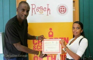 Jerry Bascombe, REACHWITHIN Youth Programme Coordinator, presents a care professional with her certificate