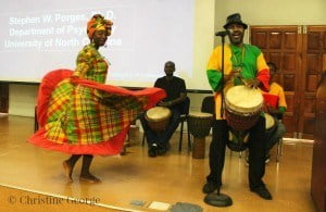 Monty, Grenadian traditional drummer, performs with his group at the 2015 child and caregiver conference