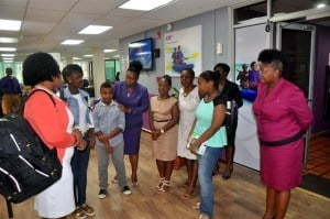 Following the presentation of the school supplies the students were taken on a complete tour of the ICBL Roebuck Street office by Human Resource Administrator, Claire Collins (fourth from left).