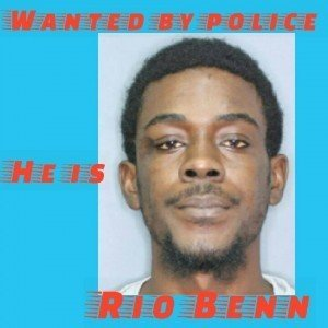 "Benn, whose last known address is Upper Duke's Alley, Bridgetown, St. Michael, is about 5'9"" in height, medium build and of brown complexion. He has black hair, average nose, eyes, ears and lips and has a scar between the right temple and right eye. He also has a tattoo of the name 'Rio' in a banner on his upper right arm."
