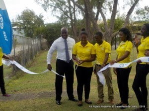 Angeline Catling (scissors in hand) joined SOL Petroleum's Barbados Country Mgr Ezra Prescod in the Park to assist with the official Ribbon Cutting Ceremony which marked the completion of SOL's Children Matter Most Beautification Project.