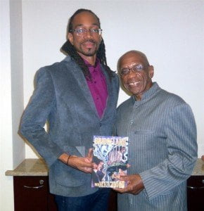 Bridgeland: Volume One author Marc R. D. Gibson is all smiles with Governor of the Central Bank of Barbados,  Dr. DeLisle Worrell after he received his signed copy of the graphic novel.