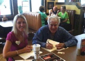 """American author Richard W. Connelly Sr. signs copies of his autobiographical novel """"Blood Detective"""" for fans."""
