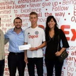 Digicel's CEO, Johhny Ingle, (second from left) congratulating young, Brendan Sidaway (second from right), who has been accepted at the Merrist Wood College in Surrey, England, home of the Chelsea FC Foundation Ladies and Mens Football Academy. His parents, Rory and Juliette Sidaway look on.