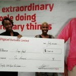 Digicel Marketing Manager, Krystle Smith (left), presenting Anya Joseph, the first lucky winner in the Digicel Summer Promotion, with her $5,000 BBD cheque