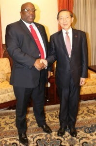 Prime Minister Harris and Foreign Minister David Lin greet each other