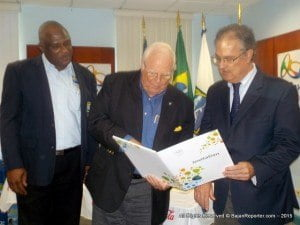 (L to R) BOA's Operations Mgr, Glyne Clarke observes when President of the BOA, Steve Stoute receives the official invitation from Ambassador Luiz De Andrade of the Brazilian Embassy.
