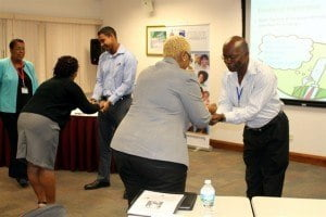 Under the guidance of facilitator, Anne Diaz (left), participants explored their individual emotions and the importance of being neutral in the mediation process during an interactive exercise on The Self.