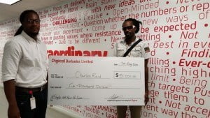 Digicel Marketing Executive, Marc Massiah (left), presenting the Week Three winner of the Stay Up With Digicel Summer Promotion, Charles Reid, with his $5 000 cheque.