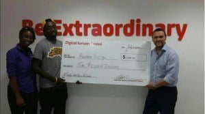 1. Week Two winner of the Stay Up with Digicel Promotion, Kareem Surage (centre) collecting his $5000 cheque from Digicel's CEO,  Johnny Ingle (right) and Marketing Manager, Krystle Smith (left).
