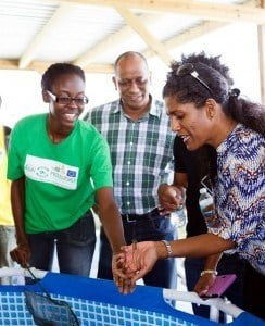(L-R) Seatonia Blackman explains crayfish farming to Dr. Stephen Boyce of the EU, and Dr. Esther Byer, Minister of Labour, Social Security and Human Resource Development during a tour of Adams Aqualife recently.