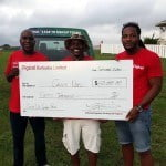 Calvin Noel (centre) accepting his prize from Digicel's Kerrigan Roach (left) and Marc Massiah