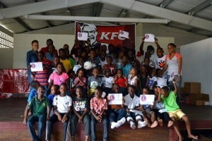 Participants, counsellors and mentors celebrate with their achievement certificates following the Pinelands Youth Soccer Academy Camp awards ceremony.