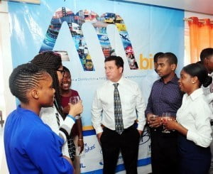 Nicholas Mouttet, Chief Executive Officer of ANSA McAL (Barbados) Ltd. (centre) chats with interns from the group's first internship programme (from left): Sharese Yarde, Sharika Brathwaite, Nicole Walcott, Kris Cadogan, and Leslie-Ann Greenidge.