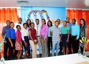"Seventeen interns have given ANSA McAL (Barbados) Ltd.'s inaugural internship programme a resounding ""thumbs up"". Here they are with Human Resources Administrator, Nadia Jemmott (sixth from left) and Group Organisational Development Manager, Monique Hassell (ninth from left)."