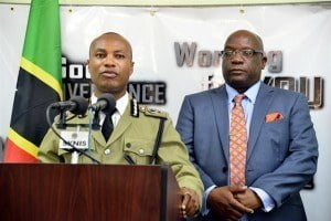 Assistant Commisioner of Police, Vaughn Henderson addressing media with SKN Prime Minister and Minister of National Security, Dr. Timothy Harris present