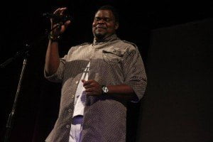 Lexus Ryan during his poetry recital on stage at CARIFESTA XII in Haiti, August 2015. (© CARICOM photo)