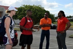 NBA coaches Chris Clunie (second from left) and Becky Bonner (left) in discussion with Digicel's Marc Massiah (right) and RMJ Agencies, Ricky Nurse (second from right), just after they arrived in Barbados for the Digicel Grassroots Basketball JumpStart Clinics.