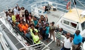 Participants preparing to board the submarine