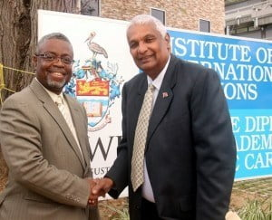 Professor W. Andy Knight, Director of the Institute of International Relations at The UWI greets the Honourable Winston Dookeran, Minister of Foreign Affairs of the Republic of Trinidad and Tobago, outside the new Diplomatic Academy building before the reception.