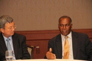 (L-R) Deputy Managing Director of the International Monetary Fund Min Zhu and Premier of Nevis and Minister of Finance Hon Vance Amory at a meeting with stakeholders at the Four Seasons Resort on 02nd September 2015
