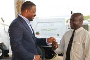 Deputy Premier and Minister of Health on Nevis Mark Brantley hands over keys to two state-of-the-art Kenworth garbage collection trucks to General Manager of the Nevis Solid Waste Management Authority Andrew Hendrickson at a handing over ceremony at the Long Point landfill on 17th September 2015