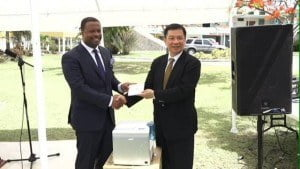 Resident Ambassador of the Republic of China (Taiwan), His Excellency Chiou Gow-Wei (right) presents information systems to Deputy Premier and Minister of Health in the Nevis Island Administration Hon. Mark Brantley at the grounds of the Alexandra Hospital