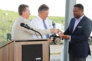 Deputy Premier and Minister of Health on Nevis Mark Brantley receives keys to two state-of-the-art Kenworth garbage collection trucks from Omni Global's Caribbean Region Operation Manager Steve Hammond, Omni Global Representative Davis Johnson at a handing over ceremony at the Long Point landfill on 17th September 2015