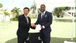 Resident Ambassador of the Republic of China (Taiwan), His Excellency Chiou Gow-Wei (right) presents wheelchairs to Deputy Premier and Minister of Health in the Nevis Island Administration Mark Brantley at the grounds of the Alexandra Hospital