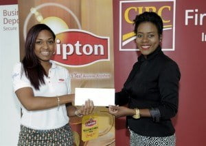 Elisha Stuart Walk Manager for Barbados accepts the cheque from Danielle Broome from Brydens Stokes Agents for Lipton Tea
