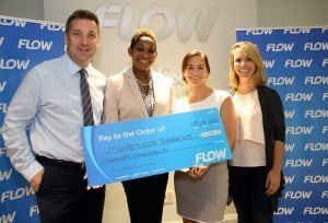 Left to right: Managing Director of Flow Barbados, Niall Sheehy and Director of Communications Marilyn Sealy presenting the cheque to More4Kids Communications Director Gabrielle Logan and Director Natasha Heaselgrave