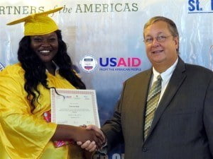 J'nievlyn Kelly of Washington Archibald High School, receives her prize for being the Most Improved student in the Employability Skills Training.