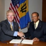 Stephen P. Holmes, Chairman and Chief Executive Officer, Wyndham Worldwide, and Everton Walters, Chairman, Barbados Tourism Investment Inc., finalize agreement to develop 450-room Sam Lord's Castle Barbados, A Wyndham Grand Resort. (PRNewsFoto/Wyndham Hotel Group)