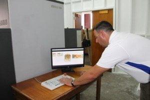 ADANI's Vice President, Operations Scott Ortilani demonstrates cargo x-ray