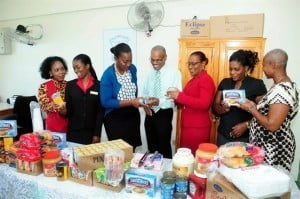 Officials of CIBC FirstCaribbean International Bank Speightstown and St. Lucy Primary School during the presentation of breakfast items, from left: Coordinator of the bank's Adopt-a-Cause Programme for Speightstown, Patrianne Husbands; Administrative Coordinator, Ms. Cherilina Thomas; Manager of the bank's Speightstown branch Mrs. Adena Vaughn; Principal of St. Lucy Primary School, Charles Hinds; the school's senior teacher, Beverley Chandler; parent volunteer Lisa Cumberbatch and breakfast volunteer, Sophia Griffith.