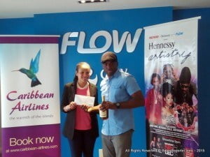 CLICK FOR BIGGER - Flow's Cherice Gooding with proxy winner Randy Moore, collecting on behalf of his 22 year old Niece