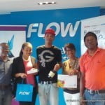 CLICK FOR BIGGER: (L to R) Alwyn Kirk - Renowned Photographer & FAS7STAR official; Cherice Gooding - Flow Services Mktg Mgr; 18 year old Kareem McCollin - Grand Prize Winner; Veena Rattan-King - Caribbean Airlines Sales Executive and Kareem's father Danny