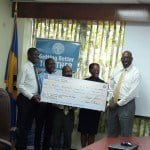Executive director of ICAB Reginald Farley presenting the cheque for $25 000 to CEO of the QEH while  Immediate Past President, Treasurer Reuben Blenman and President Lisa Padmore look on.