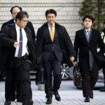 Former Seoul bureau chief of Japans Sankei Shimbun newspaper Tatsuya Kato centre arrives at the Seoul Central District Court in Seoul South Korea Dec. 17 2015.