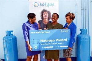 Resplendent in their blue Uniforms - Sales and Marketing Manager, Gina Cummins, and Sales Executive, Karen Bishop-McClean, both of Sol Barbados Ltd., presented the winners with their prizes at the Spring Garden complex.