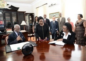 New High Court Judge, Madame Justice Pamela Beckles, takes the oath of office from Governor-General, Sir Elliott Belgrave, At Government House, under the watchful gaze of family members.