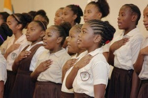 Students of the James Garbutt SDA School Choir perform the National Anthem during the launch of Phase Two of the Belize Education Sector Reform Programme in Belize City