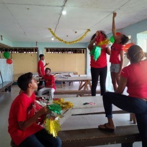 Scotiabank staff members, their children and schoolmates work on making the YMCA's headquarters festive for the children's Christmas party.