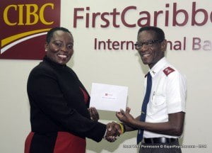 Director Retail Banking Channels - Michelle Whitelaw presents a cheque for $5,000 to Public Relations Officer for The Salvation Army Major Denzil S. Walcott.
