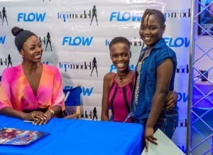 Kittisha Doyle, winner of the recently-concluded Caribbean's Next Top Model (CNTM) Cycle 2, poses with a young fan as former Miss Universe Wendy Fitzwilliam looks on.